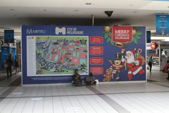 'Merry Christmas Melbourne' promotion still up at Flinders Street Station, despite Christmas being a month ago!