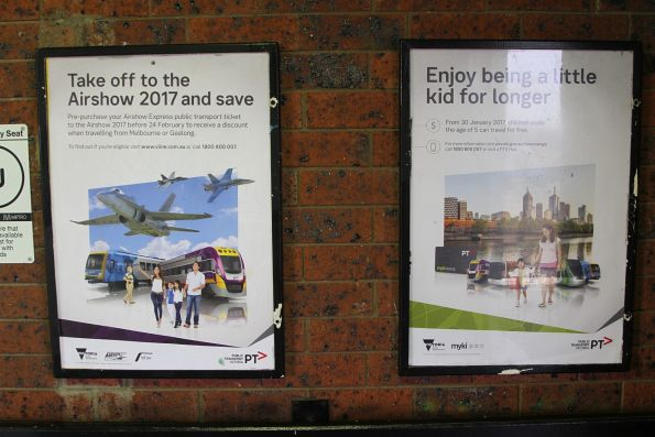 PTV posters at a railway station - Airshow 2017 travel, and expanded free travel for children