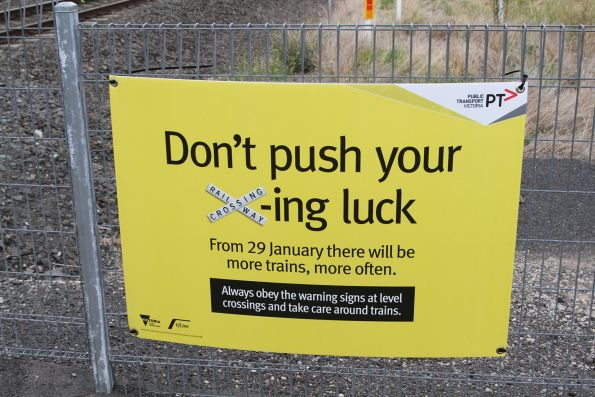 'Don't push your x'ing luck' poster at a pedestrian crossing near Ardeer