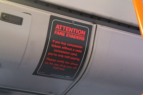 2005-era Metlink 'Attention Fare Evaders' campaign sticker still in place onboard a Transdev bus