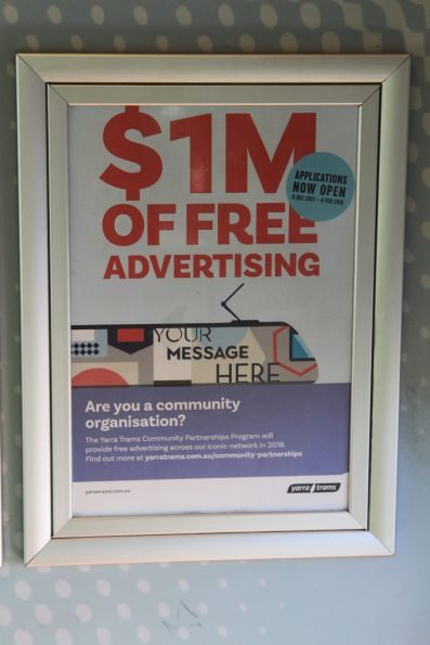 '$1 million of free advertising for community groups' poster onboard a tram