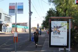 'Level Crossing Removal Project' propaganda on a bus stop at Essendon station
