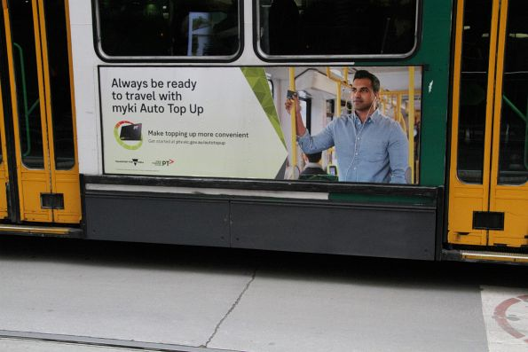 'Always be ready with myki auto top up' advertisement on the side of tram A1.235