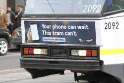 'Your phone can wait/ This tram can't. Stop before you cross.' message on tram B2.2092