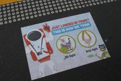 'Just landed in town? This is how we tram' sticker at a CBD tram stop