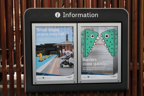 'Small slope, prams may roll' and Barriers close quickly' child safety posters at Flinders Street Station