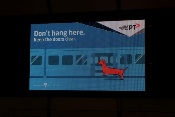 'Don't hang here. Keep the doors clear' message on the Xtrack TV screen at Flagstaff station
