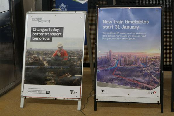 'Victoria's Big Build' and 'New timetables start 31 January' posters at Sunshine station