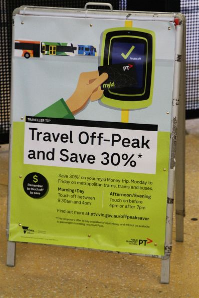 'Travel off-peak and save 30%' poster