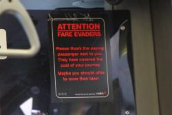 Metlink 'Attention Fare Evaders' sticker still in place onboard a Transit Systems bus
