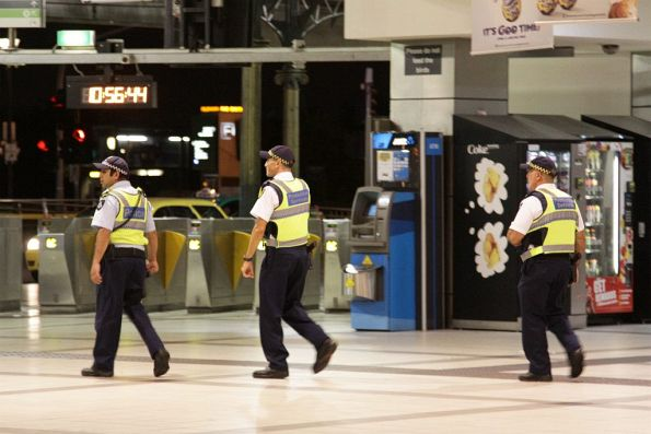 Pair of Protective Services Officers at Flinders Street Station, accompanied by a normal Victoria Police officer