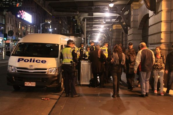 Minivan pulls up outside Flinders Street Station with tonight's roster of Protective Services Officers