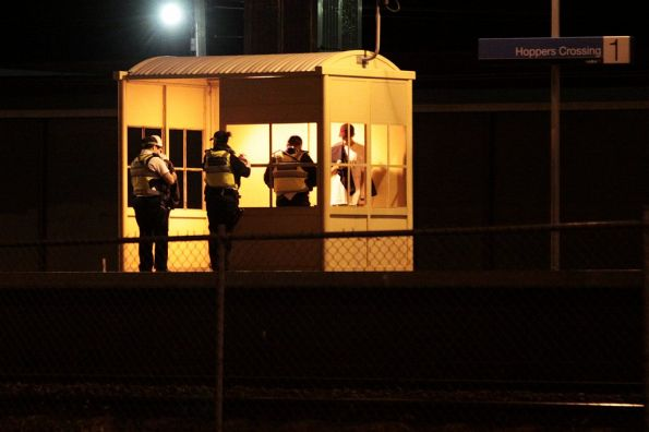 Protective Services Officers search two scruffy looking youths at Hoppers Crossing station