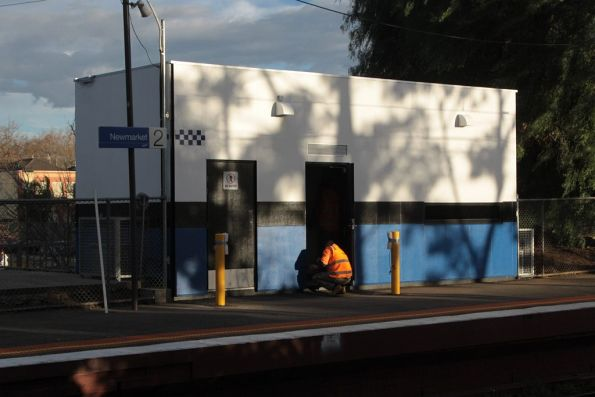 Putting the finishing touches on the Baillieu Box at Newmarket station