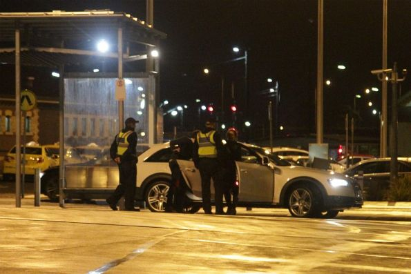PSOs talk to a motorist who drove into the bus-only road at Geelong station