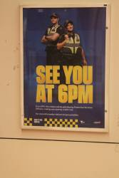 'See you at 6pm' poster promoting Protective Services Officers at a railway station