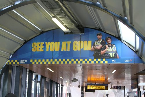 'See you at 6pm' billboard at Footscray station