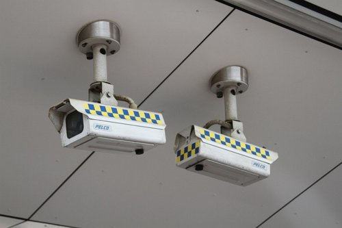 Yellow and blue PSO stripes applied to the CCTV cameras at Footscray station