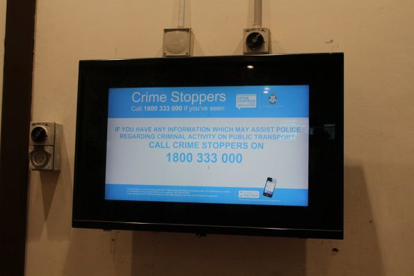 'Crime Stoppers' screen in the waiting room at Footscray station