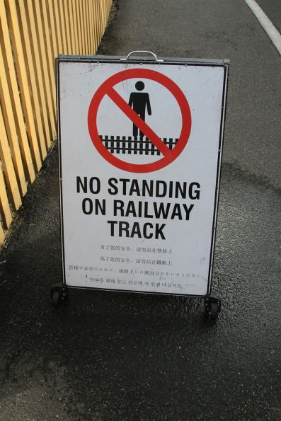 'No standing on railway track' sign at Puffing Billy