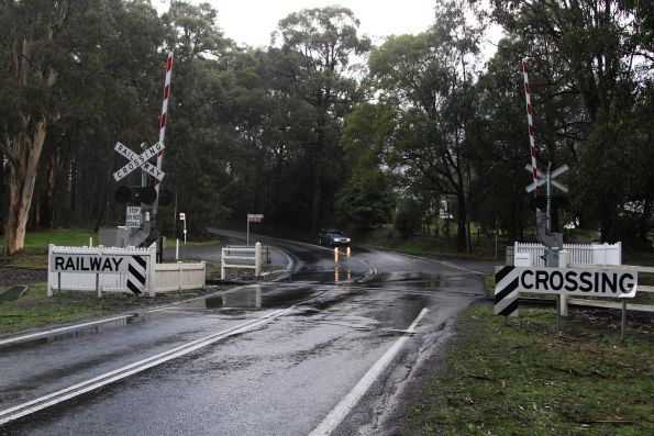 Flashing lights and boom barriers at the Belgrave-Gembrook Road level crossing in Menzies Creek