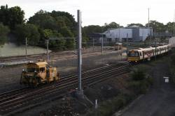 Ballast tamper MMT-032 heads along the Exhibition Loop at Normanby