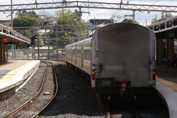 Tail end of a 'Lander' train passes through Roma Street platform 8