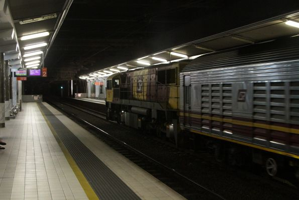 QR 2168 leads a 'lander' consist through Fortitude Valley station bound for Roma Street
