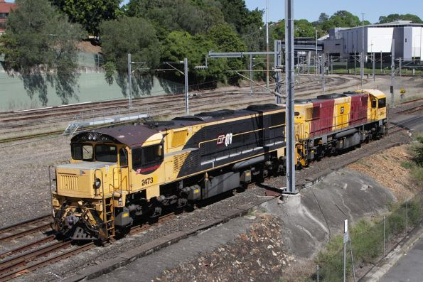 Queensland Rail locomotives 2473 and 2411 head north on the Exhibition Loop at Normanby