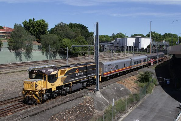 QR 2484 at Normanby with a four car long northbound train