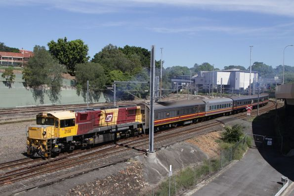QR 2158 leads a slightly longer consist out northbound at Normanby