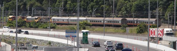 Two QR 'lander' trains overtake at Normanby