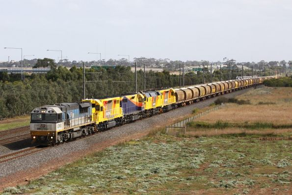 The QRN transfer passes through Hoppers Crossing: a Hitachi lurks in the background, along with a light engine A class