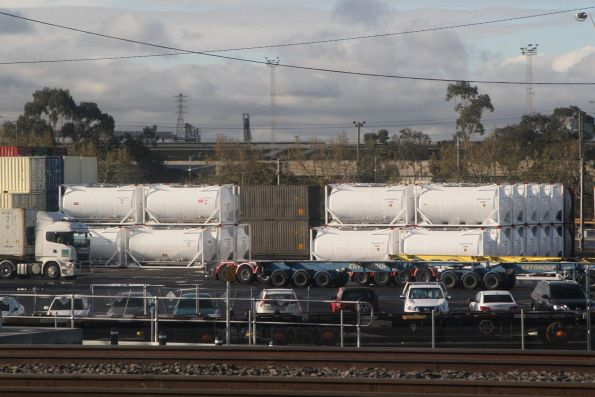 Stack of cement tank containers in the Qube terminal at North Dynon
