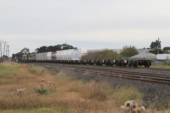 Plenty of empty flat wagons at the end of the train