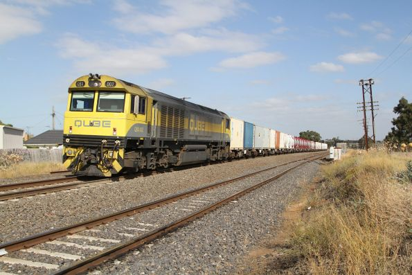 QBX002 leads the down containerised cement train towards McIntyre Loop