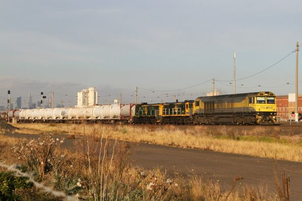 QBX001, 864 and 872 leads 3MS7 Qube cement train through Tottenham on the down