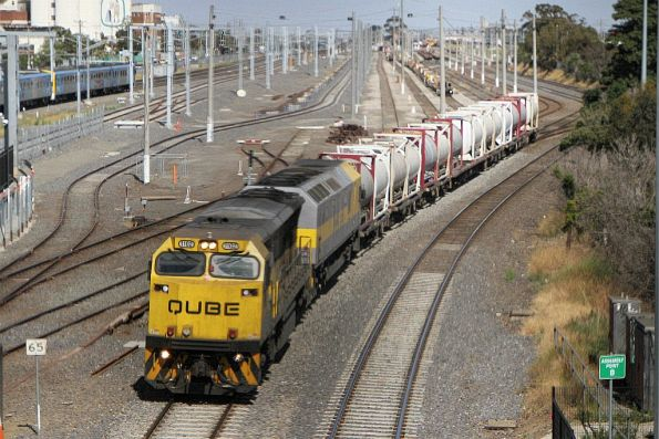 1102 leads RL309 on SM7 up cement train at West Footscray