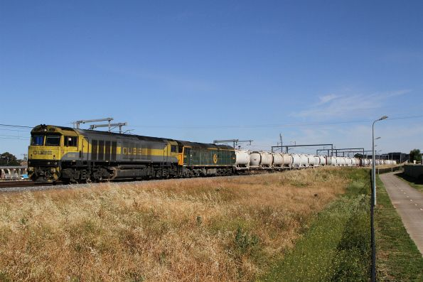 QBX002 leads 8044 on the up cement train at Sunshine