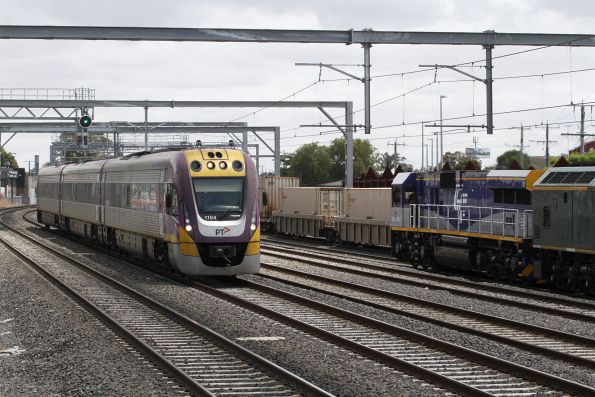 VLocity VL04 passes CM3302 and RL303 on a down standard gauge grain at Middle Footscray