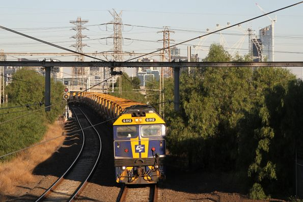 G512 heads along the high level lines at Kensington with an empty Kilmore East bound train