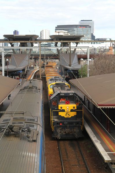 X31 leads B75 through North Melbourne station with an empty train ex-Westall