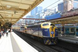 B80 leads S303 on the down Apex train through Flinders Street Station platform 7, bound for Westall