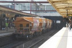 Loaded gravel wagons at Flinders Street Station, on the Apex trainbound for Westall