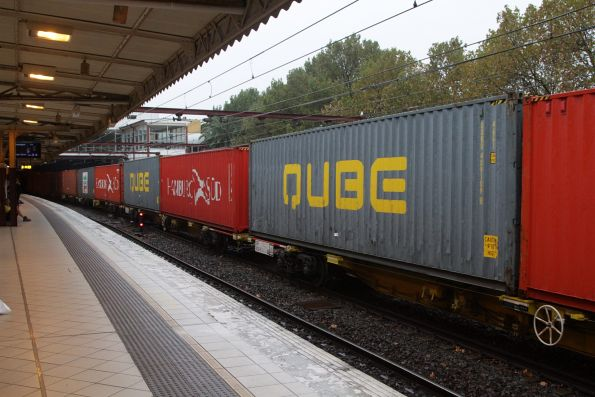 Qube containers in the consist of the up Maryvale freight at Flinders Street Station