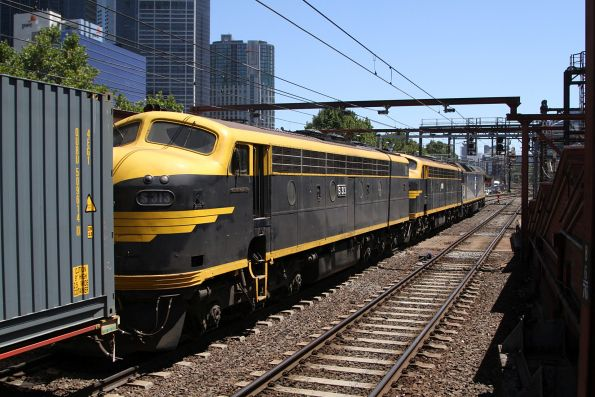 G515 leads S303 and S313 with the up Maryvale freight through Flinders Street Station