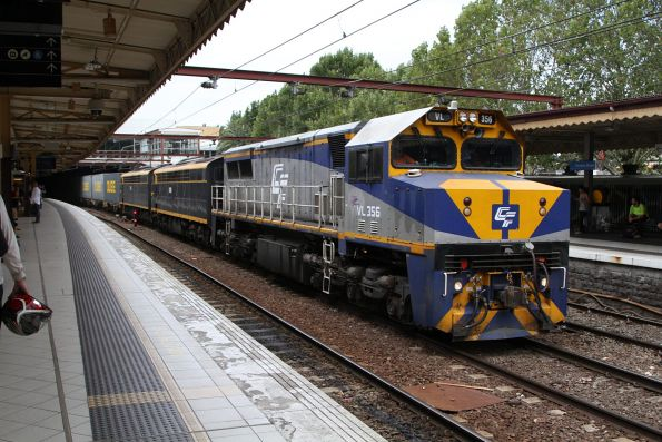 VL356 leads S303 and S313 with the up Maryvale freight at Flinders Street Station