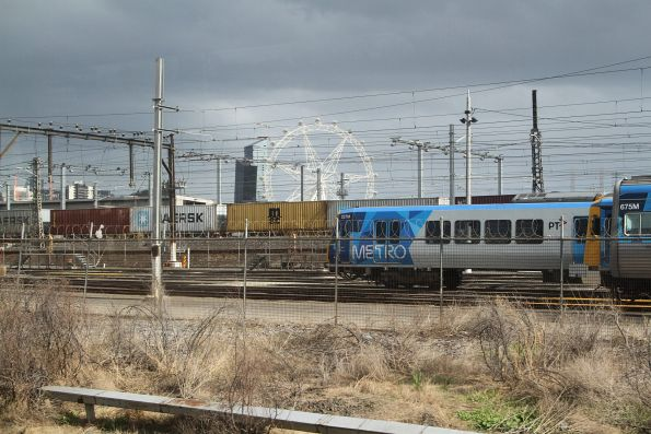 Up Maryvale train pauses outside North Melbourne station before arriving at North Dynon