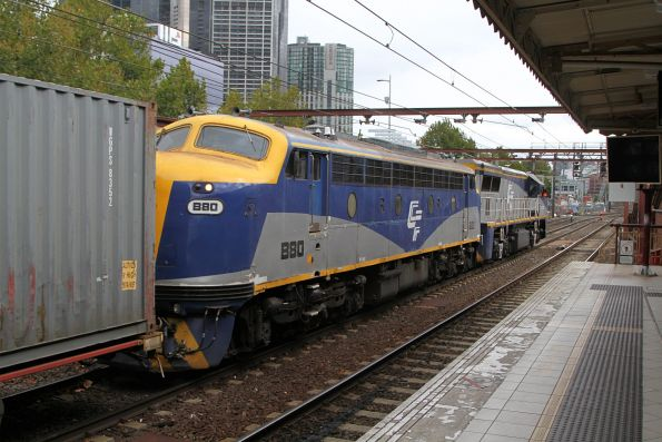 VL360 leads B80 through Flinders Street on the up Maryvale paper train