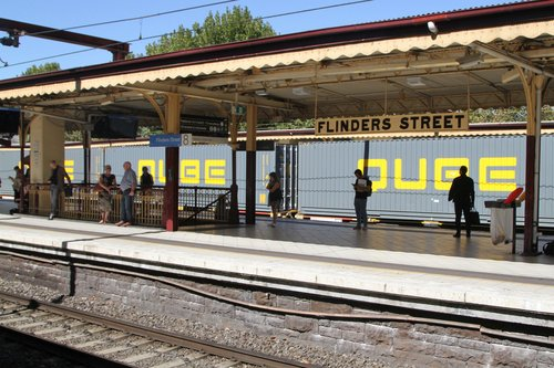 Qube containers roll through Flinders Street track 9A on the up Maryvale paper train